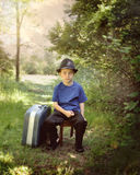 Young Travel Boy with Suitcase on Nature Trail stock image