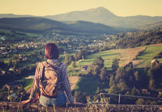 Young travel girl enjoying mountain view. Young travel girl enjoying mountain sunny view royalty free stock photos
