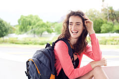 Young travel woman with backpack smiling outside Stock Photo