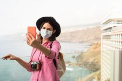 Free Young Travel Woman Taking Selfie With Mobile Smartphone Wearing Face Surgical Mask - Travel Influencer Having Fun In Vacation Stock Photo - 190202630