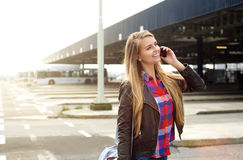 Young travel woman walking and talking on mobile phone Stock Photos
