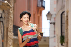 Young travel woman walking in town with bag and map Stock Image