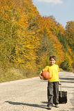 Young traveler. Young boy coming home with his luggage and ball royalty free stock photos