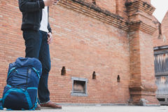Young traveler, asian man wearing black jacket and blue jeans st Stock Photography