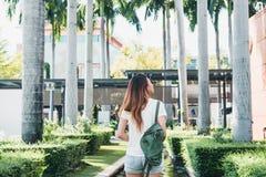 Young traveler asian woman admiring beautiful sunny narrow streets in Bangkok, Thailand. Sunny day in Bangkok, traveling in Asia. Backpacker photographer stock photo
