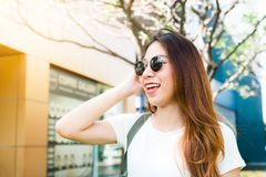 Young traveler asian woman admiring beautiful sunny narrow streets in Bangkok, Thailand. Sunny day in Bangkok, traveling in Asia. Backpacker photographer royalty free stock images