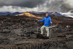 Young traveler on a background of volcanic rock. royalty free stock photos
