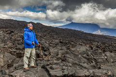Young traveler on a background of volcanic rock. Stock Image