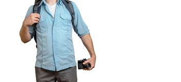 Young Traveler Blogger Man With Backpack And Film Camera. Hiking Tourism Journey Concept. Unrecognizable Traveler Blogger Man With Backpack And Film Camera Royalty Free Stock Photography