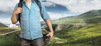 Young Traveler Blogger Man With Backpack And Film Camera In Mountains. Hiking Tourism Journey Concept. Unrecognizable Traveler Blogger Man With Backpack And Film Royalty Free Stock Image