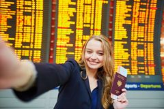 Young traveler doing selfie in the international airport Royalty Free Stock Images