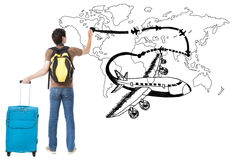 Young traveler drawing airplane and airline path on the map. Over white background royalty free stock photo