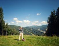 Young traveler enjoying mountain view. Young traveler enjoying summer mountain view Stock Photography