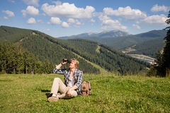 Young traveler enjoying mountain view. At sunny day Stock Photos