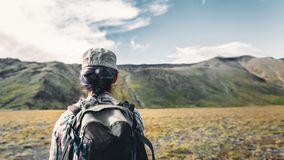 Young Traveler Girl With Backpack Is Engaged In Hiking In Mountains, Rear View. Tourism Adventure Lifestyle Concept. A young girl with a backpack is engaged in royalty free stock image