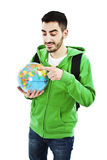 Young traveler with globe Stock Photo