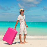 Young traveler with his luggage on a tropical beach Royalty Free Stock Photography