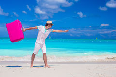 Young traveler with his luggage on a tropical beach Royalty Free Stock Images