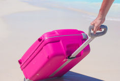 Young traveler with his luggage on a tropical beach Stock Photography