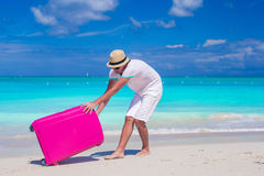Young traveler with his luggage on a tropical beach Stock Photos
