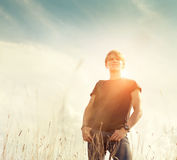 Young traveler man portrait over blue sky background Royalty Free Stock Image