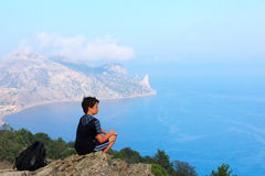 Young traveler at the mountain top Royalty Free Stock Photography