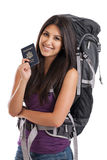 Young traveler with passport. Beautiful young mixed race Mexican Japanese woman wearing backpack carrying US passport isolated on a white background Stock Images