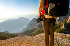 Young traveler photographer on the mountain Royalty Free Stock Photos