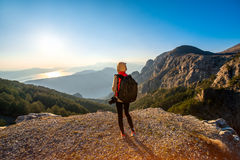 Young traveler photographer on the mountain stock photography