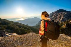 Young traveler photographer on the mountain Royalty Free Stock Images
