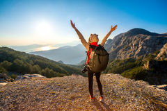 Young traveler photographer on the mountain Royalty Free Stock Image