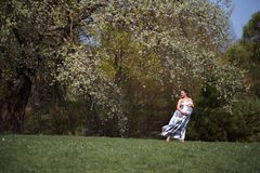 Young traveler pregnant woman walking, running, turning around and enjoys her leisure free time in a park with royalty free stock photography