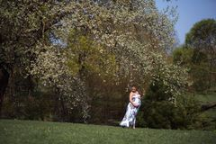 Young traveler pregnant woman walking, running, turning around and enjoys her leisure free time in a park with stock images