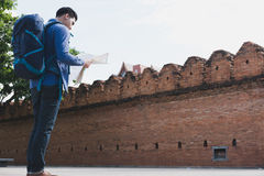 young traveler reading map. asian man wearing blue shirt and jea Royalty Free Stock Photography