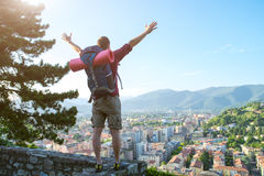 Young traveler standing with open arms Stock Photos