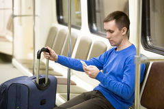 Young traveler in subway train Stock Image
