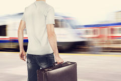 Young traveler on train station Royalty Free Stock Photos