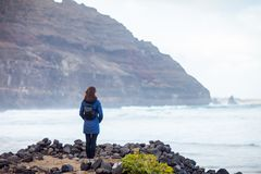 Young traveler woman enjoy ocean on black volcanic beach in Lanz stock images