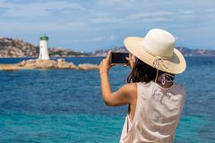 Young traveler woman making photo with mobile phone camera of li royalty free stock photography