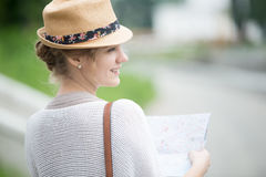 Young traveler woman in straw hat holding map. Back side view Royalty Free Stock Photos