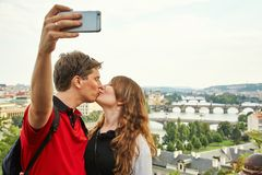 Young travelers couple in love walking on a street of European city. sightseeing traveler taking selfie photo. Prague stock photo