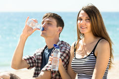 Young travelers  drinking  bottled water Royalty Free Stock Images