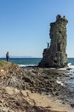 Young travelers enjoying the ruins of a genoese tower on the coast of the Cap Corse, France. royalty free stock images