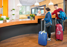 Young travelers at hotel check in Stock Image
