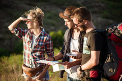 Young travelers looking for route on map, walking in canyon. Stock Image