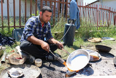 Young  traveling artisan retinning old copper dish in village of Carev Dvor,Resen,  Macedonia. Af Stock Images