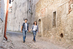 Young traveling couple having a walk on an old medieval street Stock Image