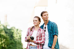 Young traveling couple: taking pictures of old town. Stock Image