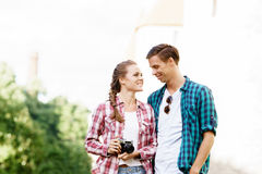 Young traveling couple: taking pictures of old town. Royalty Free Stock Images