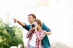 Young traveling couple: taking pictures of old town. Vacation, summer, holiday, journey: concept Stock Photos